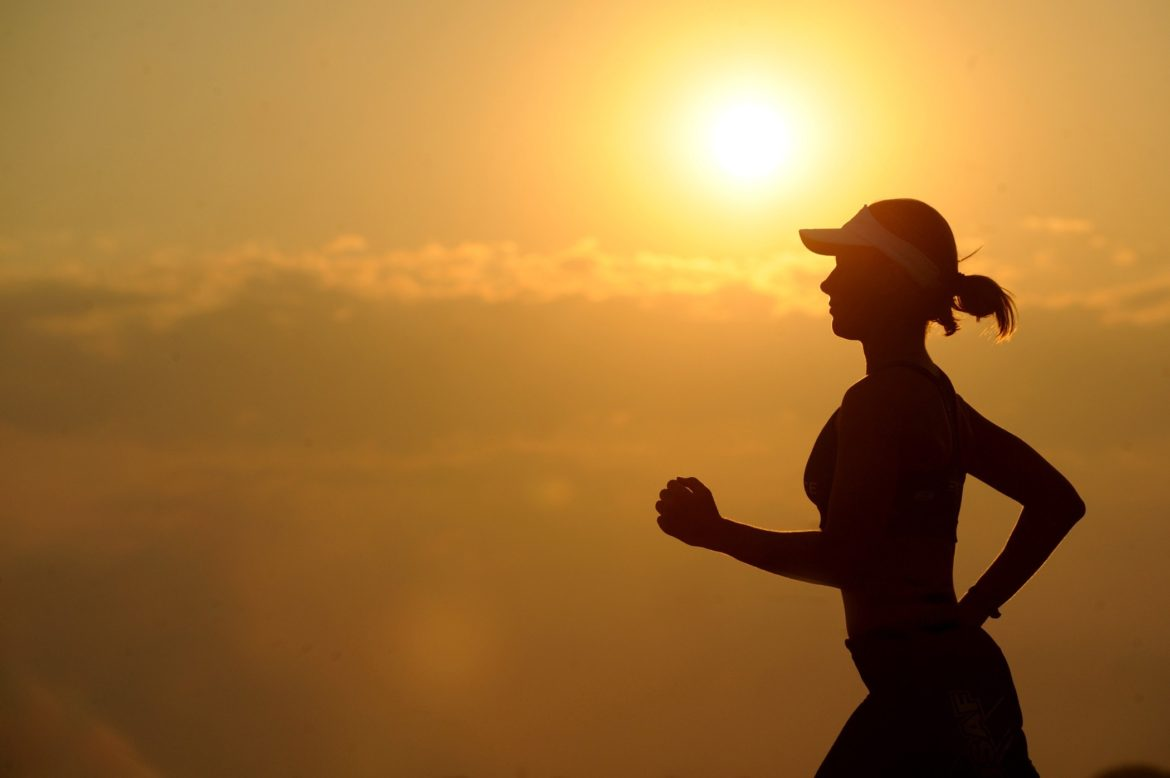A Person Jogging Against the Sunset