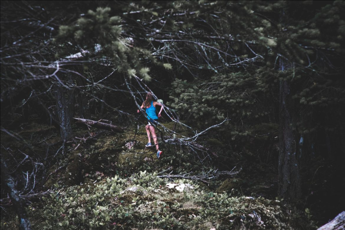 A Person in a Forest to Trail Run