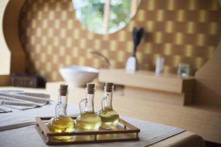 Three Cruet Bottles of Oil on a Table