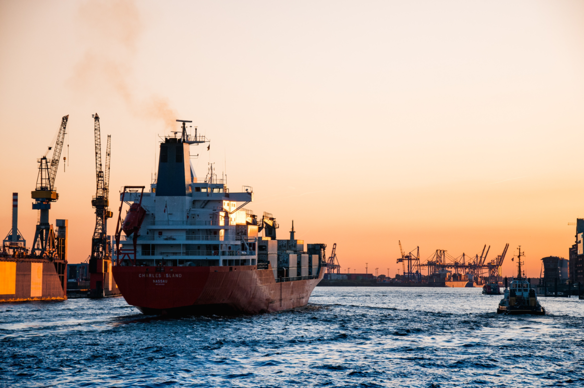 A Cargo Ship During Sunset