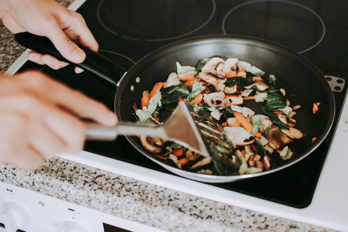 A Person Stir Frying Vegetables