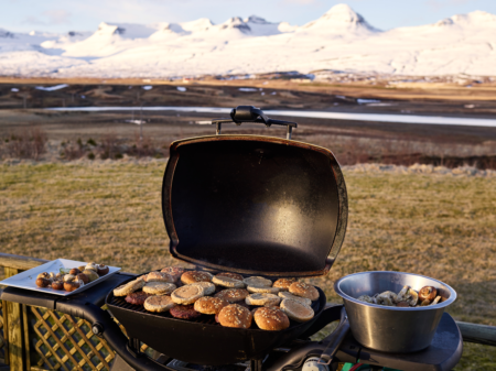 Buns and Beef Patties Set on a Barbeque Grill