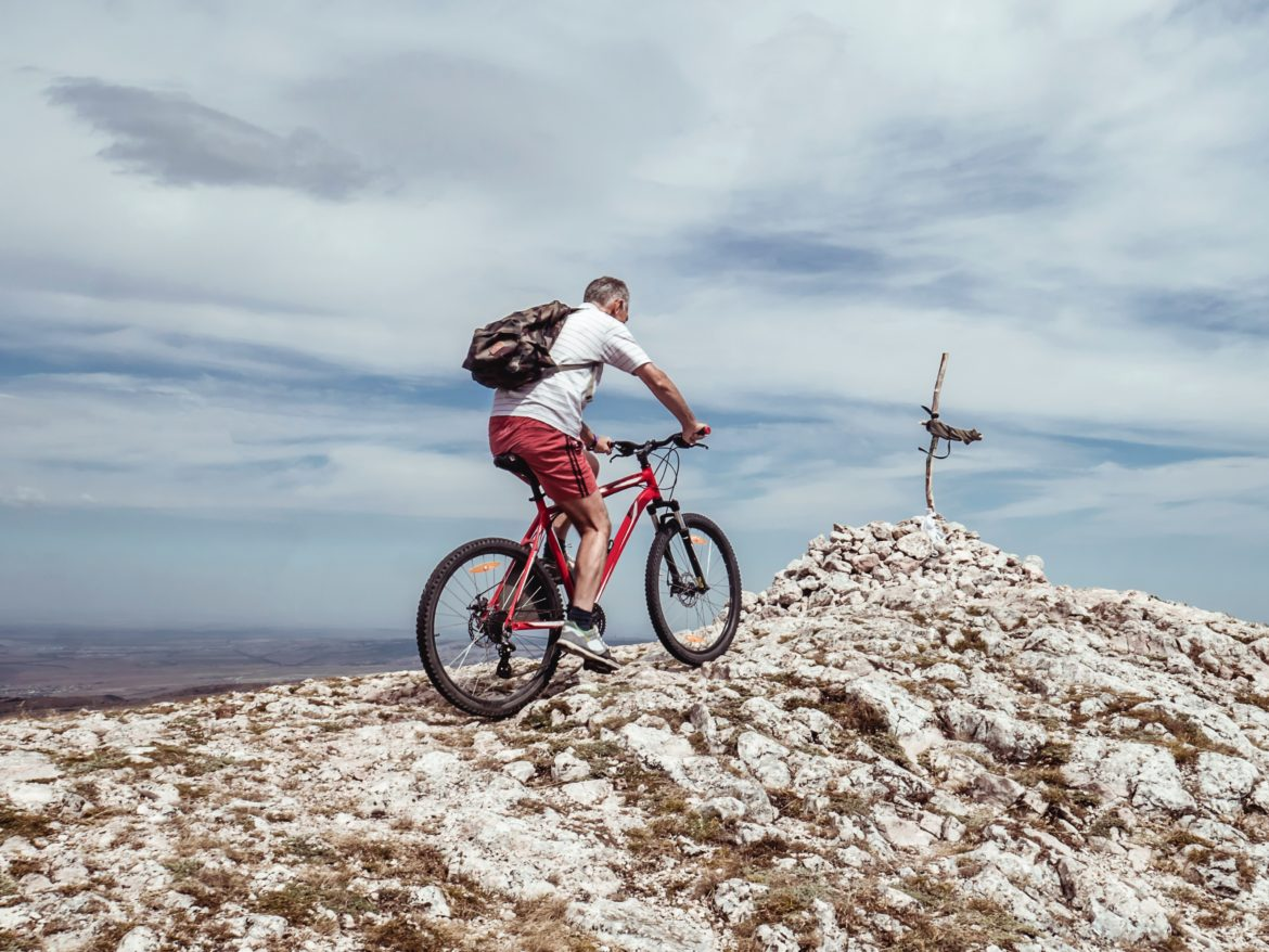 Person Riding A Bike on A Rocky Surface