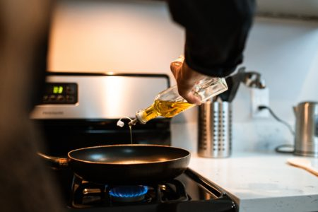 Oil Being Poured in a Wok